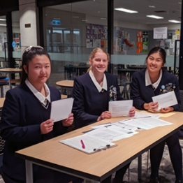Prefects Amber, Genevieve and Natasha with some of the letters to healthcare workers
